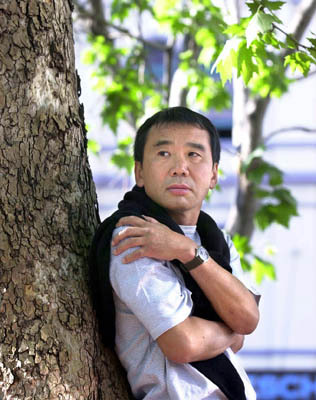 52books:  I'm pretty sure Haruki Murakami and I used the same guy for our senior portraits.
