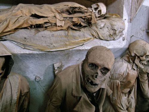 Capuchin Mummies, Italy  More than 400 years ago, the monks at the Capuchin monastery in Palermo, Sicily, discovered that deceased friars interred in catacombs underwent natural mummification. Word got out, and the order began allowing ordinary citizens to be buried there as well. Now, visitors can see thousands of preserved corpses, most wearing the tattered remains of their finest garments, arranged in the macabre museum's narrow halls.