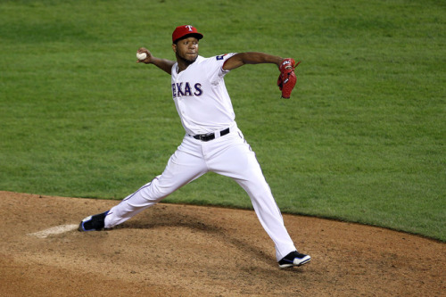 Neftali Feliz of the Texas Rangers pitches in the ninth inning during Game Five of the MLB World Series against the St. Louis Cardinals at Rangers Ballpark in Arlington on October 24, 2011 in Arlington, Texas. The Rangers won 4-2. (Photo by Ezra Shaw/Getty Images)