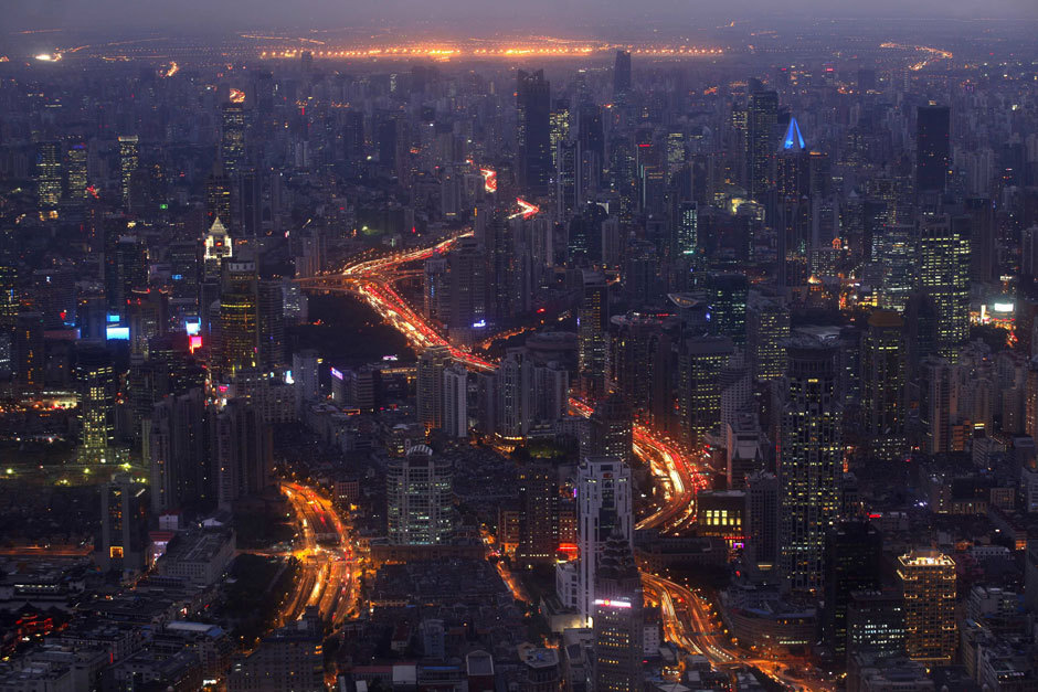 Photos of the day A view of the city skyline from the Shanghai Financial Center building, October 25, 2011. The world's population will reach seven billion on October 31, 2011, according to projections by the United Nations. (Carlos Barria / Reuters)