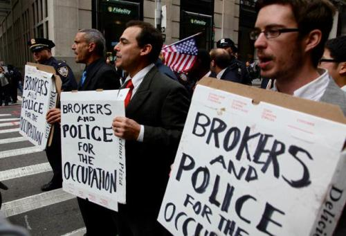 It looks like renegade brokers and members of the NYPD march with Occupy Wall Street! What?? Is it opposite day? Photo by Velcrow Ripper via Occupy Love See our continuing coverage of #ows