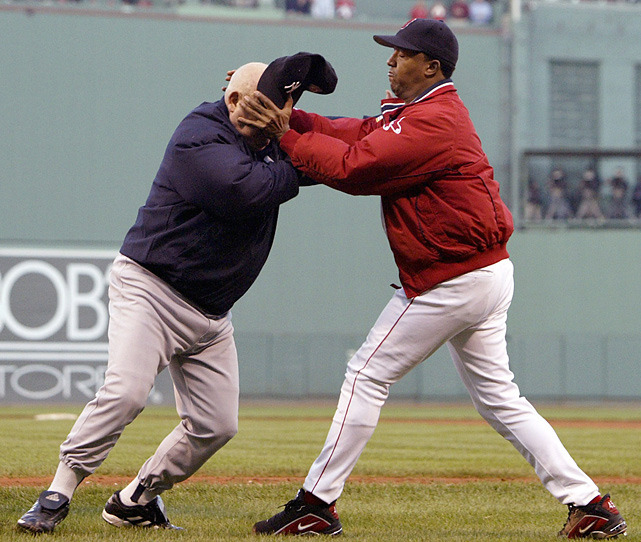 Red Sox pitcher Pedro Martinez throws Yankees bench coach Don Zimmer to the ground during a brawl in Game 3 of the 2003 ALCS. Martinez turns 40 today. (AP) SI VAULT: Heated series between Red Sox and Yankees gets physical (10.20.03)SI VAULT: Zimmer's malleable mug is the face of genius (9.25.89)SI VAULT: The power of Pedro has turned the Sox into a contender (3.27.00)GALLERY: Red Sox-Yankees all-time greatest moments