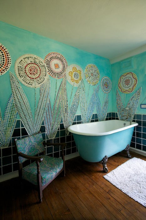 Fun and colorful bathroom with mosaic tile flowers and a turquoise tub (via Voewood | Photographs)