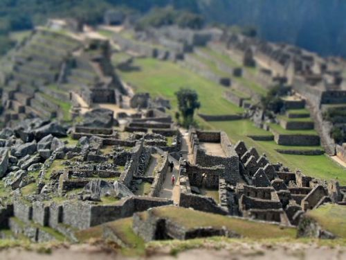 "Machu Picchu, Peru. Photograph by Claire Wroe.The tilt shift lens, often used in architectural photography, is fun to  use for rendering actual settings into scale-model worlds in which  people look like toy figures. Because you're altering the planes of  focus and drawing the eye to a narrow area of the photograph, a specific  point of interest must be included. In this image, the two small  figures walking through the ""maze"" are essential elements. - Catherine Karnow"