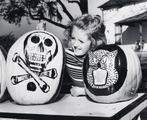 Little girl with decorated pumpkins 1956