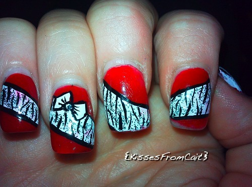 I did my nails ! Red , Zebra & Tiny Bows <3