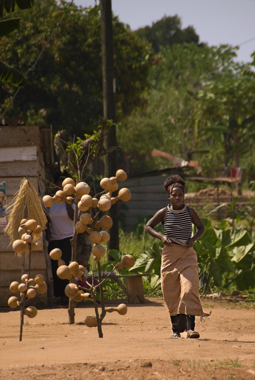 A Gourd store keeper, on the road from Kampala to Masaka, Uganda. Photography by Rob & Ale