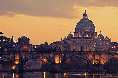 A look back across the Tiber River at Saint Peter's Basilica and Ponte Sant'Angelo. allthingseurope:  St Peters Basilica and the River Tiber, Rome, Italy (by bhawi)