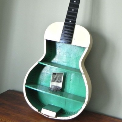 storagegeek:  DIY Guitar Curio Shelving via Shelterness There are always guitars at thrift shops that have seen better days. No name models that do not break the aficionado's heart. This would be a fun project for a kids room or family room I think. I found this photo ages ago but forgot to save a source. I found it again at Shelterness but still no source so if you know the source please let me know!  what a good idea! i love this!