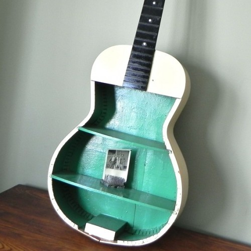storagegeek:  DIY Guitar Curio Shelving via Shelterness There are always guitars at thrift shops that have seen better days. No name models that do not break the aficionado's heart. This would be a fun project for a kids room or family room I think. I found this photo ages ago but forgot to save a source. I found it again at Shelterness but still no source so if you know the source please let me know!