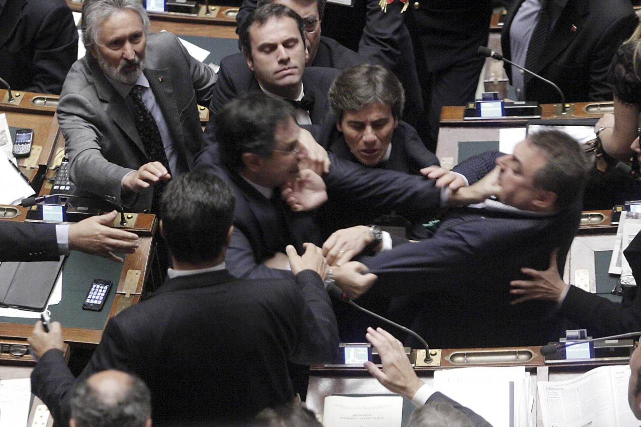 nationalpost:  Stress getting to Italian politicians Italian parliamentarians literally went at each others' throats as tense negotiations over severe new austerity reforms boiled over into a governmental brawl Wednesday.Deputies from the Northern League, part of the ruling coalition, fought with members from the opposition FLI party of speaker Gianfranco Fini, grabbing each other by the throat as other party members rushed to break up the fight, Reuters reported from Rome. (Photo: Ansa/Giuseppe Lami/Reuters)  Finance reform in Italy. This is like a scene out of Akira.