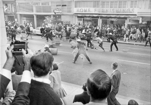 "occupyhistory:  Police versus protesters in downtown Oakland, during the anti-Vietnam ""Stop the Draft Week."" October 20, 1967. Photograph by Bill Crouch. Courtesy of the Oakland Museum of California. With police brutality at Occupy Oakland all over the news, it's worth remembering that Oakland has a rich history of protest. On October 20, 1967, four thousand people marched through the streets, blocking Army buses, clashing with police. This was the biggest demonstration against the Vietnam War up to that point. At a sit-in at the Oakland Army Induction Center, even Joan Baez got arrested. Then, as now, police violence turned the streets into a warzone. In the 1960s, however, the Oakland mayor didn't have a Facebook page where people could leave thousands of angry comments.  Interesting bit of history on the Occupy Oakland protests. In London, protesters outside St Paul's Cathedral have been told they will be evicted as the church opens up for the first time in a week. Follow the news live here."