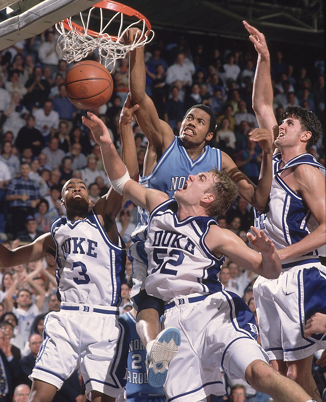 North Carolina's Rasheed Wallace dunks over two Duke defenders during a 1995 game at Cameron Indoor Stadium. (Bob Donnan/SI)