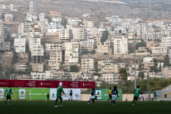 wongwong:  A match takes place against the backdrop of Gaza West-Bank houses. via footballinframes