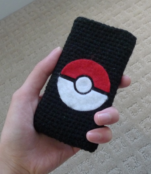 "Check out this Pokémon cell phone cozy I made for my brother!  He is a big Pokémon fan and he just got the iPhone 4S :)  I got one too, and we've been having a lot of fun asking Siri questions ;)  We made a sleek, simple cozy showcasing the Pokéball design using my second cell phone cozy tutorial here (aka the ""sock method"").  The pokéball looks kind of 3-D, as if it's popping out!  I used to love watching the anime and playing Pokémon, so this was a quick and fun project!"