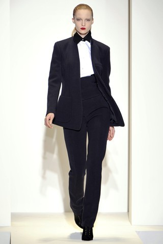 One Of The Boys Nicole Farhi Dressed-up menswear is a neat alternative for the evening - add a touch of glamour with silk ties, cummerbunds, and tuxedos A pair of sparkly trousers, teamed with a plunging shirt and  heels - as seen at Michael Kors - is the perfect formula for subverted  andro-glamour The trend showed its more  sensuous side at Dolce and Gabbana and Moschino, where monochrome was  broken up with flourishes of ornate sequins and gilded embroidery