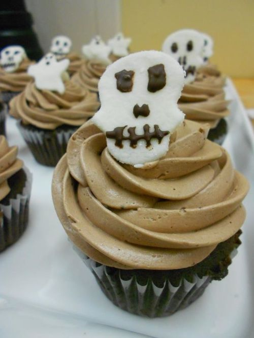 Chocolate cupcakes with chocolate frosting and marshmallow skulls!I used Dandies Vegan Marshmallows to make these. It's pretty easy but a bit time consuming if you are making a lot of skulls (or whatever shape.) To make the skulls:-dust each marshmallow in cornstarch-roll out each marshmallow until flat between 2 pieces of parchment paper-cut out your shapes with a cookie cutter-remove marshmallow from parchment paper and place on a clean sheet of parchment paper, or some other clean surface that it won't stick to-decorate with chocolate (I melt the chocolate and pipe it out of a pastry bag fitted with a  plain round size 1 tip)-eat :)
