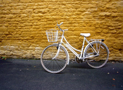 White Bike, Yellow Wall and Grey Pavement by Caro's Lines on Flickr.