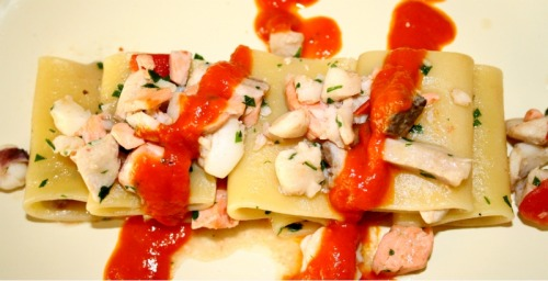"Paccheri with seafood mix ragout sprinkled with vodka and ""bloody mary"" tomatoe sauce"