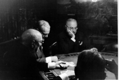 Former President Harry S. Truman at his favorite pastime, poker.  With him are Hugh J. Curran, businessman and developer of North Kansas City and Tom L. Evans.  The photo was taken without any of them actually knowing the were being photographed.  Location: 822 Club in Kansas City, Missouri.  Circa 1955. Harry Truman: Poker Player from the Truman Library
