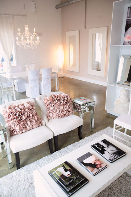Soft neutrals are enlivened with a pair of elaborately ruffled pillows (via Weddings And The City : Image #173203 : Style Me Pretty)