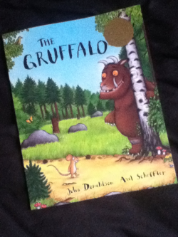 The Gruffalo by Julia Donaldson and Axel Schedfler A friend recently brought me this book and Where the Wild Things Are after finding out that I had never read them or had them read to me as a child. And I instantly fell in love with this book and must say it will be a book that I will read to my kids (when I have them).  The book may seem a little repetitive book that what you need in a children's book.  And the character mouse is one will love.