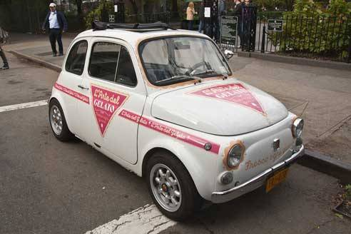 This retro Fiat 500 branded by L'Arte del Gelato caught my eye in Chelsea. L'Arte del Gelato prides itself on it's traditional Italian gelato recipe, which makes the throwback Fiat an obvious association. This brand manifestation evokes the playful, slightly decadent brand any time it scoots through a West Side Avenue. (image via Daily Heller Newsletter - Imprint-The Online Community for Graphic Designers)