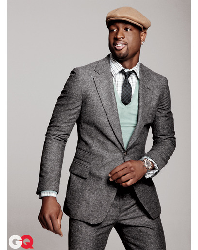 "via gqfashion:  Dwyane Wade Suits Up Lately Dwyane Wade has been looking just as sharp off the court as he does on, so we asked the Miami Heat superstar to break down his five favorite looks of the season. This is what Dwyane calls his ""Throwback Tweed Look"":  ""To wear a gray tweed suit, you have to be mature and confident in yourself. Some people can't pull it off. My thing is that I always want to do something to pop my outfit. The sweater adds that punch of color, and the driving cap grabs attention.""  Check out more looks here."