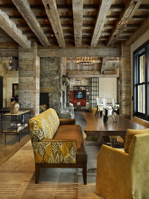 Dining room of a rustic mountain lodge home in Colorado… love the large chairs and bench seats (via  dining room - denver - by WORTH Interiors)