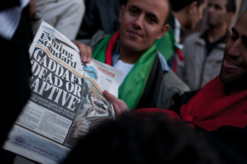 Libyan embassy, London on Flickr.A man points to a copy of the evening paper as Libyans celebrate the death of Mu'ammar Gaddafi on 20 October in fornt of the Libyan embassy.