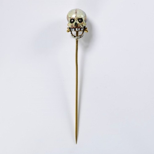 "aubade:  Auguste-Germain Cadet-Picard, stickpin, made in Paris, 1867. He made and showed ""electrical pins invented by Trouvé. At this exhibition, jewels with moving parts powered by electricity attracted a lot of attention. The jewel contains electric terminals so that, when connected to a  battery concealed in the wearer's pocket, the eyes roll and the jaws  snap."" How precious is this stick-pin? I want to put one in the collar of my blazer."