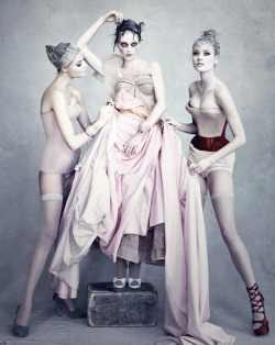 DIOR BY DEMARCHELIER - From left: corset from Haute Couture collection autumn/winter 2005; France dress, Haute Couture collection autumn/winter 2005; corset from Haute Couture collection autumn/winter 2004.