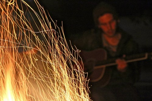 This is me. Playing guitar. Near a fire.