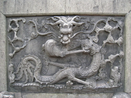 Dragon sculpture in a stone slab. Yu Yuan Garden in #Shanghai #China.
