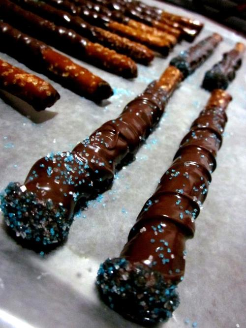 themaisisters:  chocolateforelephants:  Chocolate-Covered Wands | made by Ann & Anna This recipe is super easy and was inspired by Dumbledore's Vegan Army's version. It's pretty self-explanatory, but check out the link to their recipe for detailed instructions! We used Ghiradelli's semisweet chocolate chips and left out the shortening. A spoon was used to make the swirls while the chocolate was applied, which was great fun. I think I will take up chocolate swirling as a hobby.   ^Here's what we've been up to, if you were wondering. c: