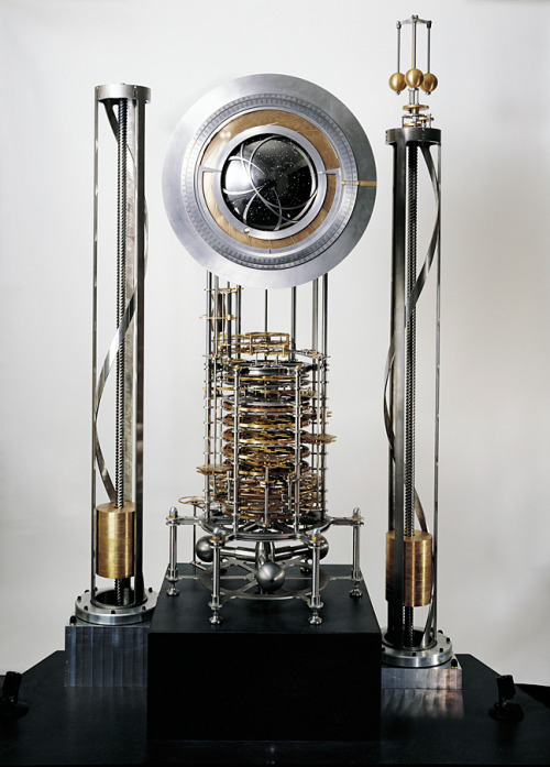 infoneer-pulse:  Engineering the 10 000-Year Clock  The year is 12011. Two hikers cut through a stretch of cactus-filled desert outside what was once the small town of Van Horn, near the Mexican border, in West Texas. After walking for the better part of a day under a relentless sun, they struggle up a craggy limestone ridge. Finally they come to an opening in the rock, the mouth of what appears to be a long, deep tunnel. As they head into the shadows, not quite knowing where the tunnel will lead, the sudden darkness and the drop in temperature startle their senses. After a few minutes the hikers reach a cool chamber dimly lit from above. A tall column of strange shiny metal gears and rods rises hundreds of meters above them. Steps cut into the walls spiral upward, and the hikers ascend until they reach a platform. A black globe suspended above depicts the night sky, encircled by metal disks that indicate the year and the century. A giant metal wheel sits in the middle of the platform, and the visitors each grasp a handle that juts out from its smooth edges. For the next several hours, they push and walk and push and walk in a circle, methodically, silently, until the wheel will turn no further. Exhausted, they rest on the platform and drift off to sleep. At noon the next day, they're suddenly awakened by the ethereal tones of chiming bells. It sounds like science fiction, but this is the real vision for the 10 000-Year Clock, a monument-size mechanical clock designed to measure time for 10 millennia. Danny Hillis, an electrical engineer with three degrees from MIT who pioneered parallel supercomputers at Thinking Machines Corp., worked for Walt Disney Imagineering, and then cofounded the consultancy Applied Minds, dreamed up the project in 1995 to get people thinking more about the distant future. But the clock is no longer just a thought experiment. In a cluttered machine shop near a Starbucks in San Rafael, Calif., it's finally ticking to life.  » via IEEE Spectrum
