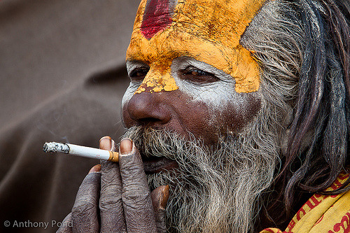 delucazade:  Sadhu enjoying a smoke (by anthonypond)