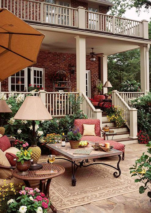"A lovely ""classically formal"" outdoor living space acts as a second living room during warmer weather (via Better Homes and Gardens - Decorating Gallery)"