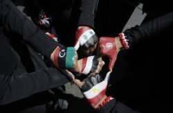 Female Yemeni protestors show their hands painted with flags of Libya, Syria, Yemen, Tunisia , and Egypt, during a demonstration demanding the resignation of Yemeni President Ali Abdullah Saleh in Sanaa, Yemen, Friday, Oct. 28, 2011. (AP)