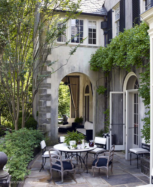 Charming outdoor dining patio made of slate
