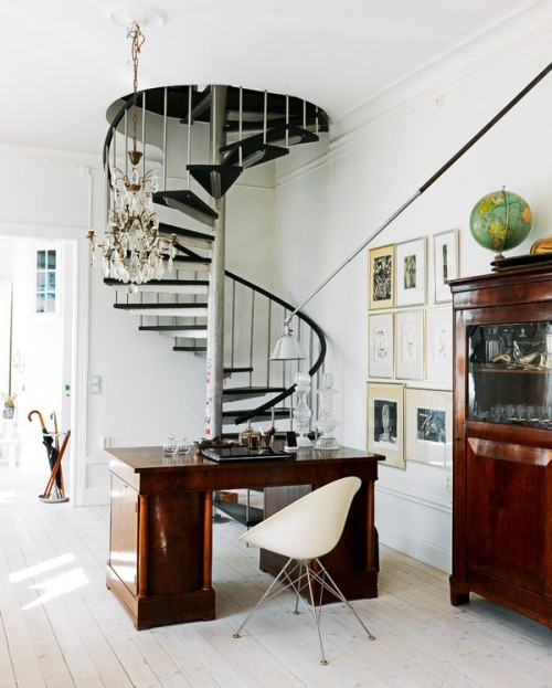 Love the fantastic spiral staircase in the corner, and the eclectic details