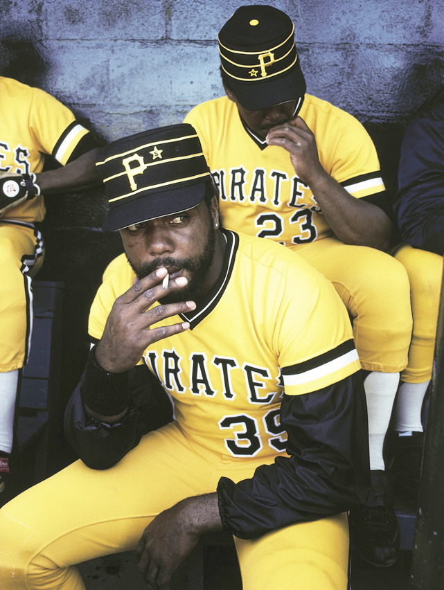 Pirates OF Dave Parker takes the edge off with a dugout cigarette during a 1980 spring training game at McKechnie Field in Bradenton, Fla. (Walter Iooss Jr./SI) SI VAULT: Parker, Madlock have Pirates playing like champs (8.8.83)