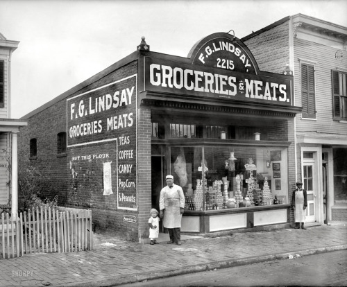 "Washington, D.C., circa 1925. ""F.G. Lindsay store front, Anacostia, 2215 Nichols Avenue."" Exterior of the grocery seen here. National Photo Co. View full size."