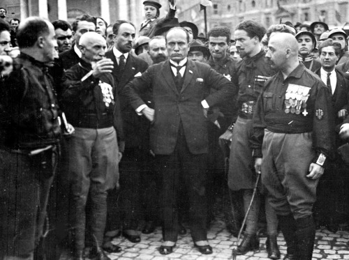 "The March on Rome: Benito Mussolini surrounded by his Blackshirt allies during the March on Rome. The same day that this picture was taken, Mussolini legally assumed power with the consent of King Victor Emanuel III.  His official role in the new government was Prime Minister. Three years later he named himself ""Il Duce"" (the leader), and held power as dictator until his demise during WWII. October 28, 1922 - 89 years ago today."