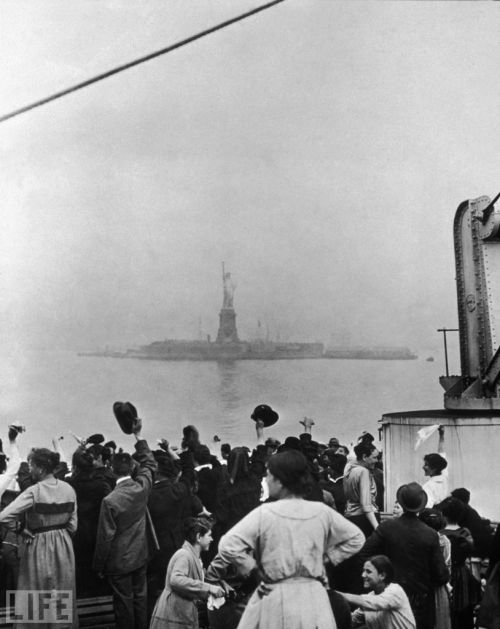 life:  On this day in 1886: The Statue of Liberty is unveiled. As a gift from France, President Grover Cleveland dedicated our lady liberty in New York Harbor. Pictured: A group of immigrants traveling aboard a ship celebrate as they catch their first glimpse of the Statue of Liberty and Ellis Island in New York Harbor. (see more — American Classic: Lady Liberty)