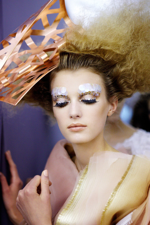 tmagazine:  When applied correctly, the sparkly stuff can impart a bright, youthful energy to any look, without being juvenile. (Image courtesy of Dior) http://tmagazine.blogs.nytimes.com/2011/10/28/vain-glorious-glitter-for-grown-ups/