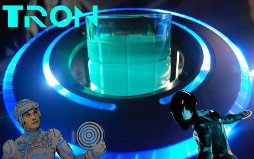 "expbaronline: TRON 1oz - Midori 1oz - Blue Curacao 1oz - Pineapple Juice Fill Sprite _________________________________ Pour first three ingredients in an old fashioned glass over ice Fill with sprite mix well Fight the MCP ""The last of our TRON themed cocktails. Tron is smooth, citrus-y and all around good. My personal favorite of all three. Tron was Alan Bradly's home made security program and he fought for the rights of the programs and users alike, in legacy he was brought over to the new system and became Rinzler, and fell into the ISO Ocean and remembered who he was."" ""I fight for the users"" ~ Tron Drink Created by expbaronline."