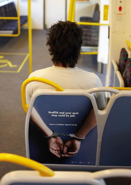 Nice ambient advertising, just wonder why the person in front of the offender gets the cuffs?! Hmm…