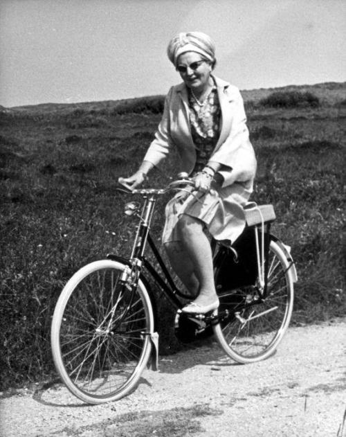 Queen Juliana riding a bike during a visit to the Dutch island of Terschelling, 1967.
