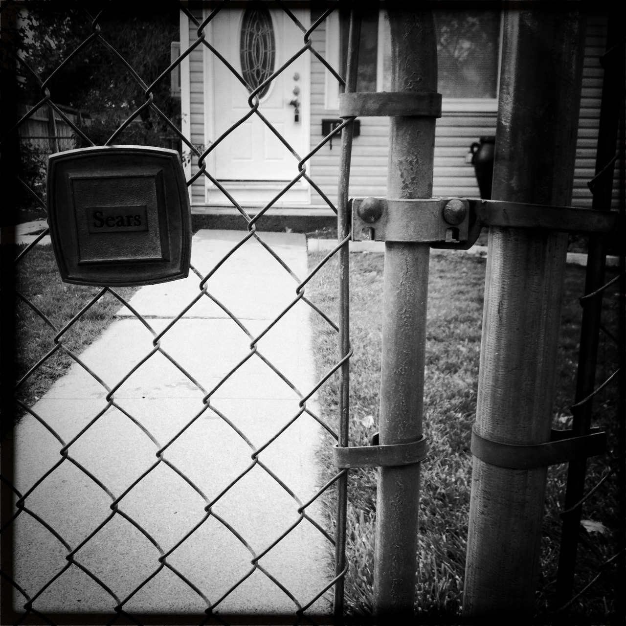 Sears Fence Taken with Hipstamatic, John S Lens, BlacKeys SuperGrain Film, No Flash.